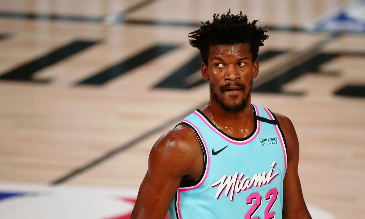 Miami Heat forward Jimmy Butler waits between plays during the first half of the team's NBA basketball game against the Indiana Pacers on Monday, Aug. 10, 2020, in Lake Buena Vista, Fla.