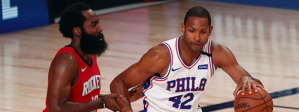 Sixers forward Al Horford (42) drives against Houston's James Harden Friday