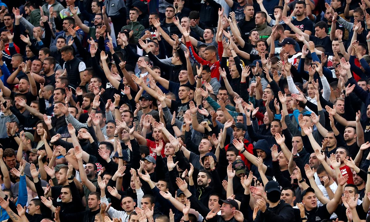 In this Wednesday, June 10, 2020. photo, Red Star (Crvena Zvezda) fans support their team during a Serbian National Cup semi final soccer match between Partizan and Red Star in Belgrade, Serbia.
