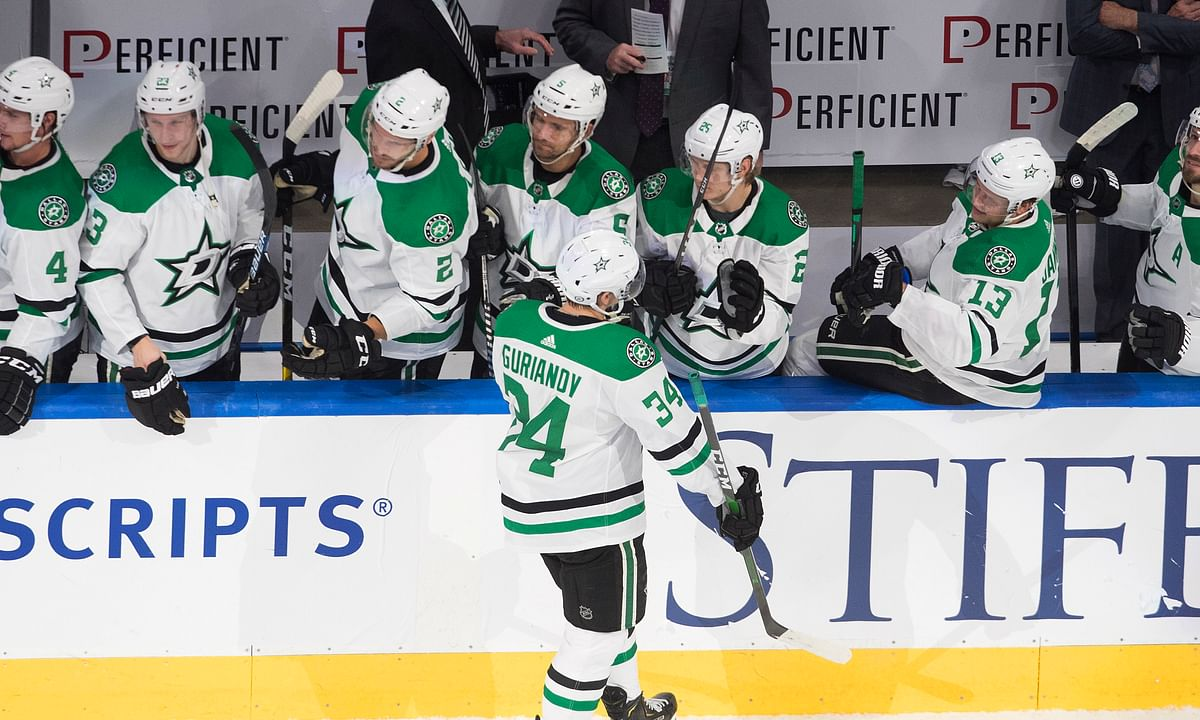 Dallas Stars' Denis Gurianov (34) is congratulated for his goal against the St. Louis Blues during the shootout in an NHL hockey playoff game Sunday, Aug. 9, 2020, in Edmonton, Alberta.