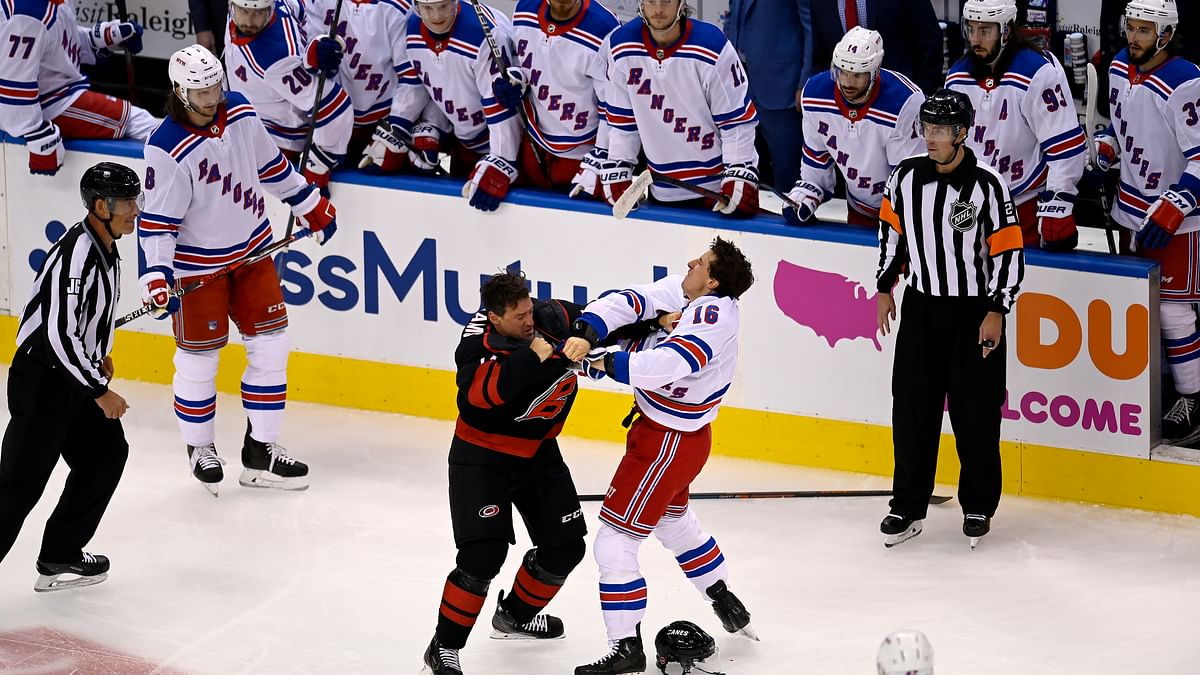 New York Rangers' Ryan Strome (16) fights with Carolina Hurricanes' Justin Williams during the first period in the NHL hockey Stanley Cup playoffs in Toronto, Saturday, Aug. 1, 2020.