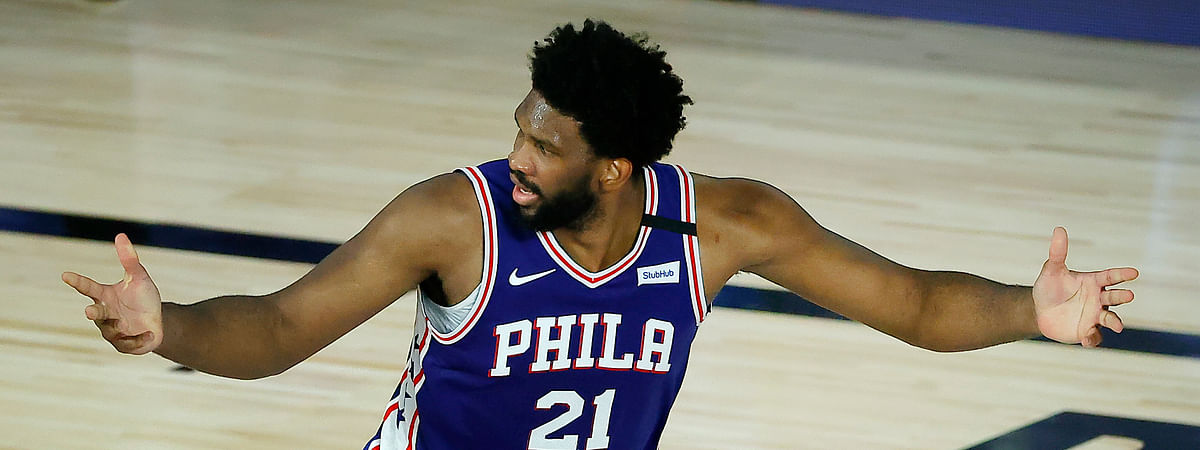 Philadelphia 76ers' Joel Embiid reacts after a basket during the third quarter of an NBA basketball game against the Orlando Magic, Friday, Aug. 7, 2020, in Lake Buena Vista, Fla.
