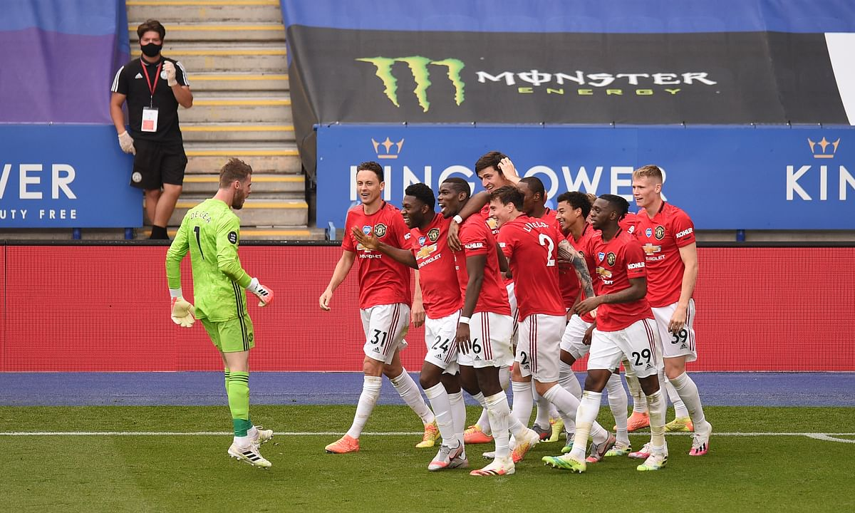 Manchester United's Jesse Lindgard celebrates with teammates after scoring his side's second goal during the English Premier League soccer match between Leicester City and Manchester United at the King Power Stadium, in Leicester, England, Sunday, July 26, 2020.