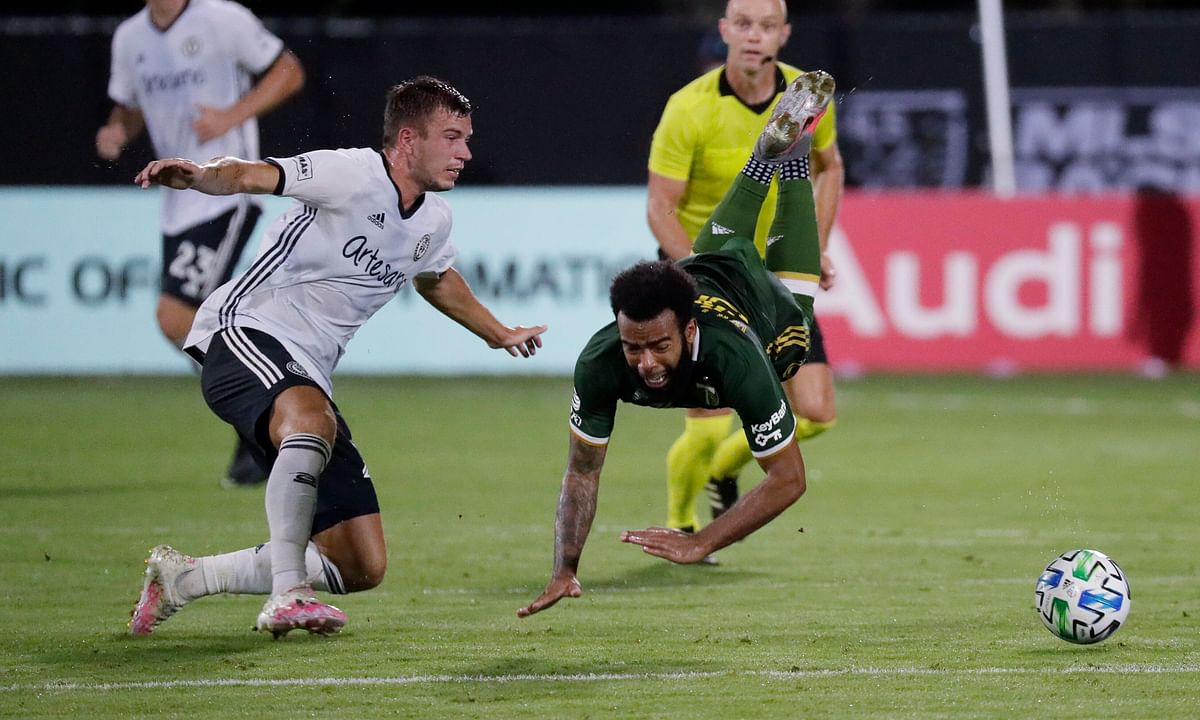 Philadelphia Union defender Kai Wagner, left, and Portland Timbers midfielder Eryk Williamson collide during the first half of an MLS soccer match, Wednesday, Aug. 5, 2020, in Kissimmee, Fla.