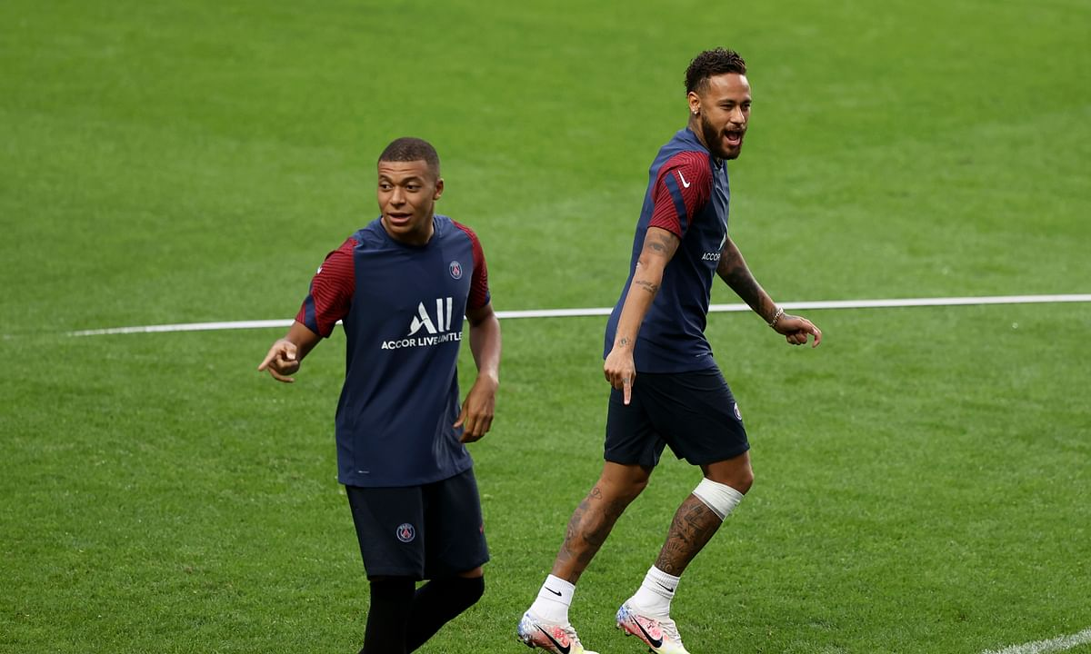 PSG's Kylian Mbappe and Neymar, right, gesture during a training session at the Luz stadium in Lisbon, Tuesday Aug. 11, 2020. PSG will play Atalanta in a Champions League quarterfinals soccer match on Wednesday.
