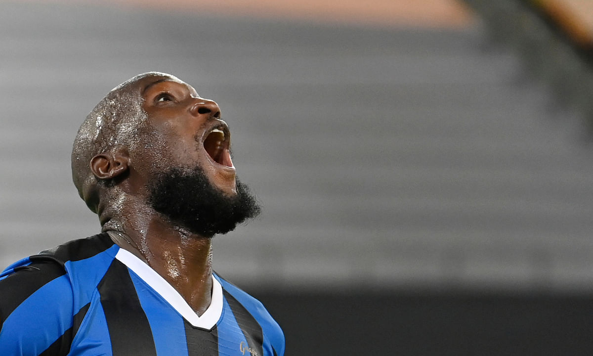 Inter Milan's Romelu Lukaku cheers after his goal for the 5:0 during a Europa League semi-final match between Inter Milan and Shakhtar Donetsk in Duesseldorf, Germany, Monday, Aug.17, 2020.
