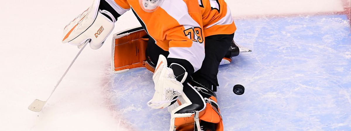 Philadelphia Flyers goaltender Carter Hart (79) fails to stop the puck on a shot from New York Islanders defenseman Andy Greene during first-period NHL Stanley Cup Eastern Conference playoff hockey game action in Toronto, Monday, Aug. 24, 2020.