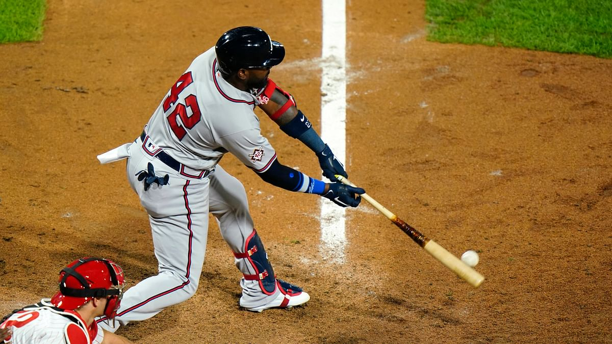 Atlanta Braves' Marcell Ozuna hits an RBI-single off Philadelphia Phillies pitcher Blake Parker during the fifth inning of a baseball game, Sunday, Aug. 30, 2020, in Philadelphia.