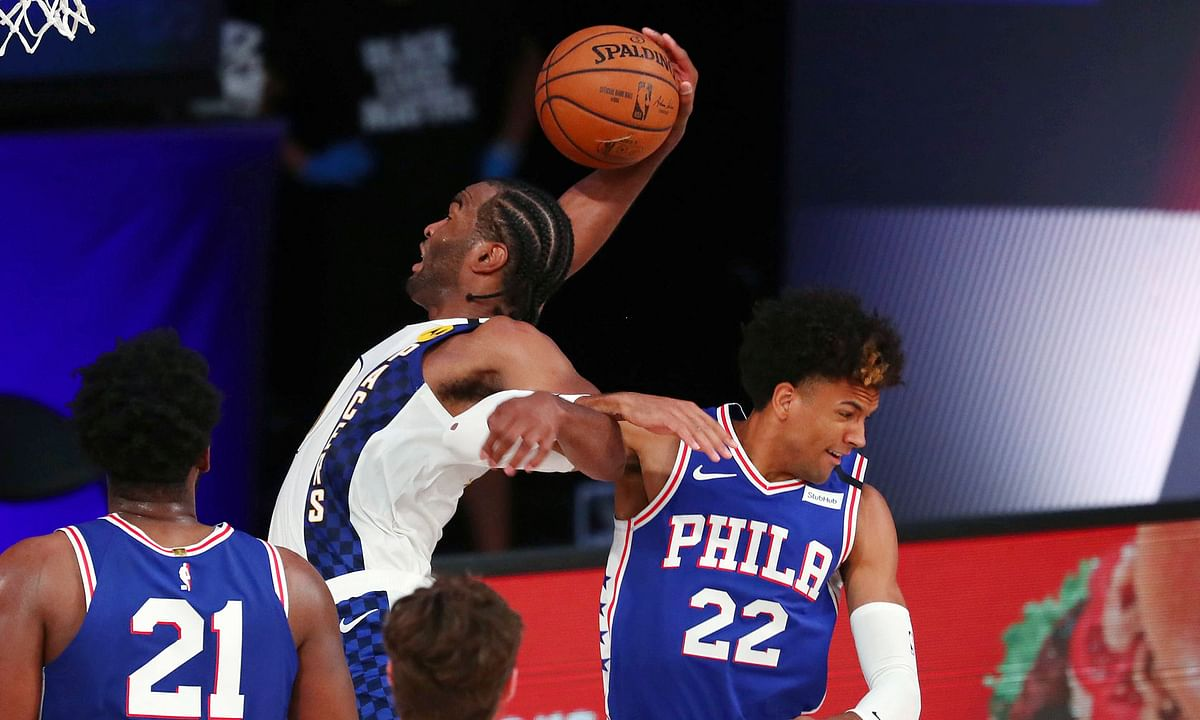 T.J. Warren (white jersey) and Joel Embiid (21) helped us capture every one of our Sixers-Pacers Totals Props on Saturday