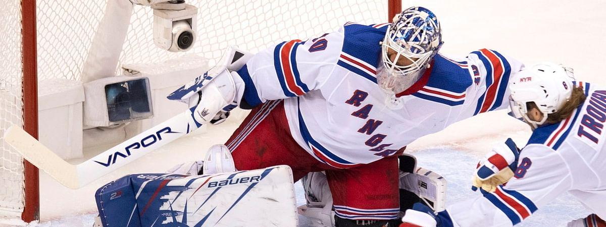 Carolina's Andrei Svechnikov fires his third goal past Rangers goalie Henrik Lundqvist Monday