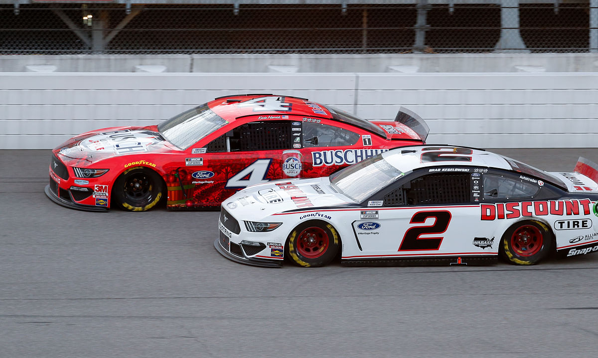 Kevin Harvick (4) competes with Brad Keselowski (2) during a NASCAR Cup Series auto race at Michigan International Speedway in Brooklyn, Mich., Saturday, Aug. 8, 2020.