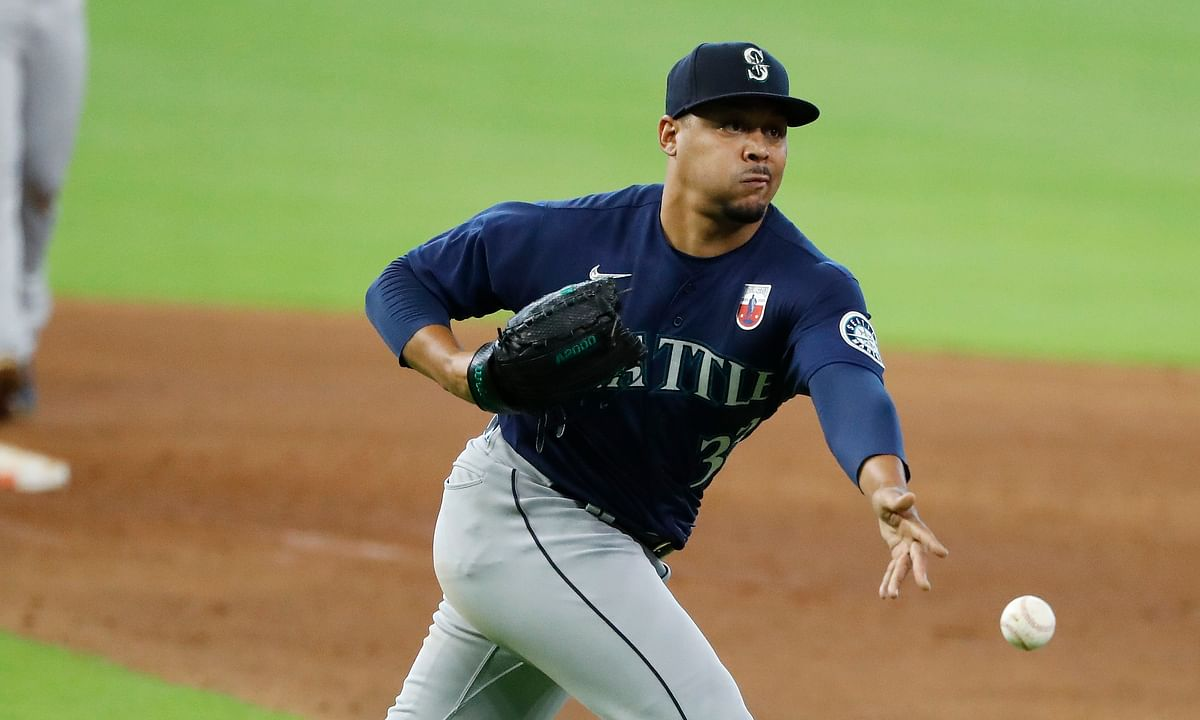 Seattle Mariners starting pitcher Justus Sheffield tosses a ground ball by the Houston Astros' Kyle Tucker to first baseman Evan White in the bottom of the sixth inning on Sunday, August 16, 2020, at Minute Maid Park.