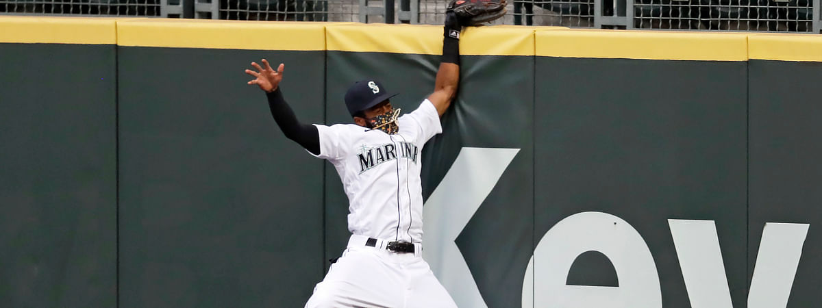 Seattle Mariners right fielder Mallex Smith hits the wall as he misses a deep fly ball from Colorado Rockies' Charlie Blackmon for a three-run double during the fifth inning of a baseball game Saturday, Aug. 8, 2020, in Seattle.