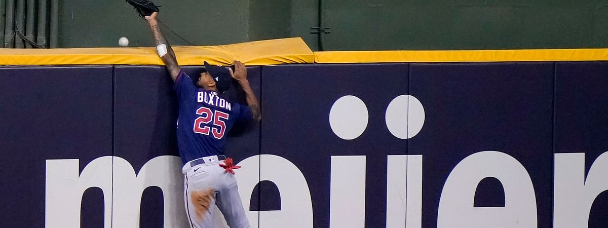 Minnesota Twins' Byron Buxton can't catch a two-run home run hit by Milwaukee Brewers' Jedd Gyorko during the eighth inning of a baseball game Tuesday, Aug. 11, 2020, in Milwaukee.