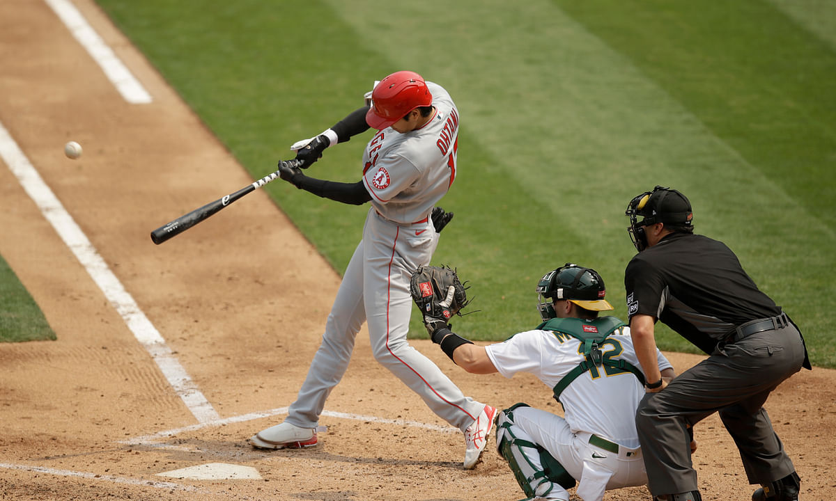Los Angeles Angels' Shohei Ohtani swings for a three-run home run off Oakland Athletics pitcher Frankie Montas in the third inning of a baseball game Sunday, Aug. 23, 2020, in Oakland, Calif.