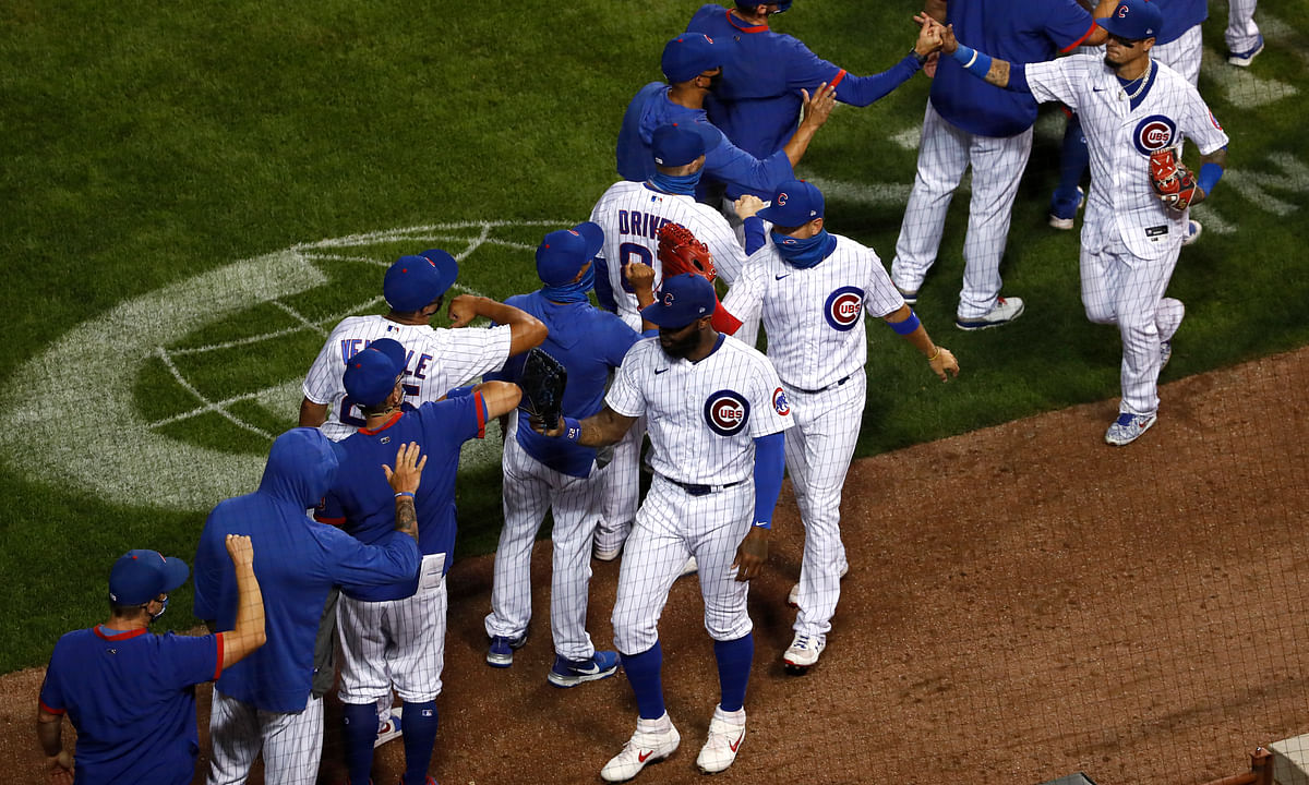The Chicago Cubs celebrate after beating the Milwaukee Brewers during a baseball game in Chicago, on Thursday, Aug. 13, 2020. The Cubs won the game 4-2.