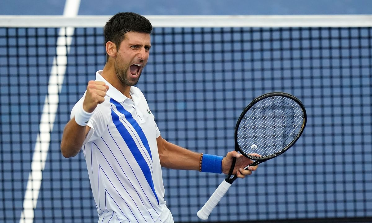 Novak Djokovic, of Serbia, reacts to winning his match with Milos Raonic, of Canada, during the finals of the Western & Southern Open tennis tournament Saturday, Aug. 29, 2020, in New York.