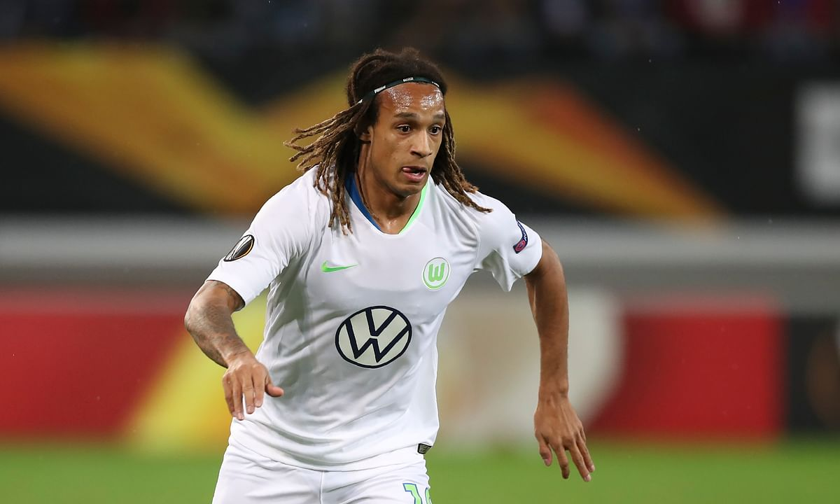 In this file photo dated Thursday, Oct. 24, 2019, Wolfsburg's Kevin Mbabu during the Europa League group I soccer match against Gent at KAA Gent Stadium in Ghent, Belgium. Wolfsburg defender Kevin Mbabu will miss his team's Europa League last-16 game against Shakhtar Donetsk after he tested positive for the coronavirus last month, the club said in a statement Monday Aug. 3, 2020.