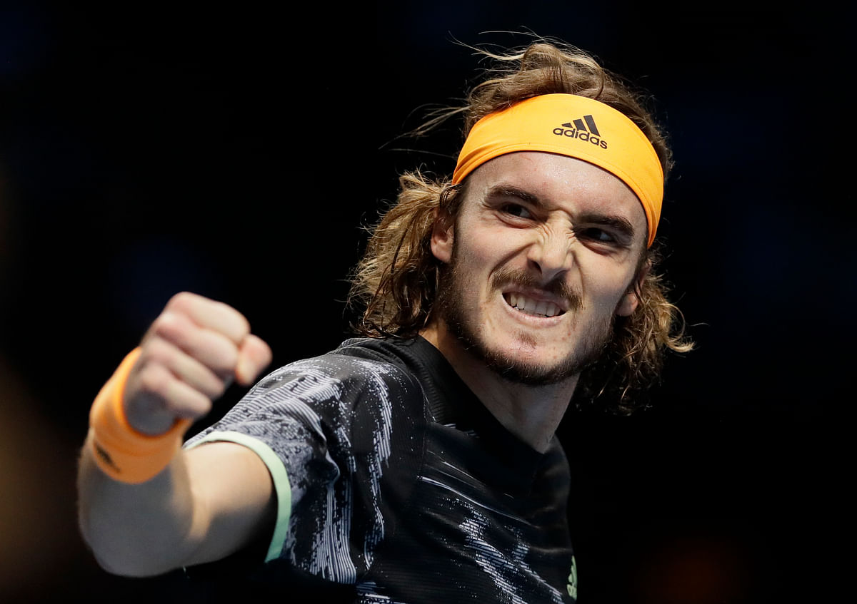 FILE - In this Nov. 11, 2019, file photo, Stefanos Tsitsipas of Greece celebrates winning a point against Daniil Medvedev of Russia during their ATP World Tour Finals singles tennis match at the O2 Arena in London. Tsitsipas is scheduled to play in the U.S. Open, scheduled for Aug. 31-Sept. 13, 2020.