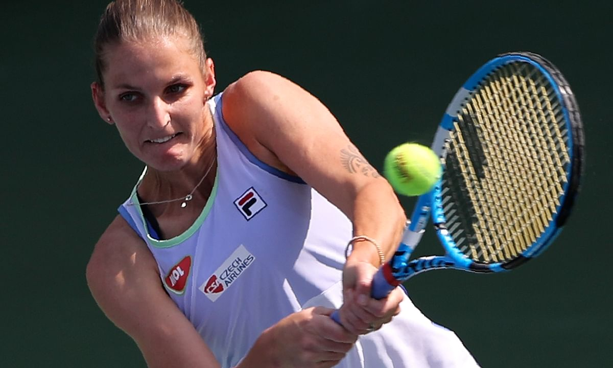 FILE - In this Thursday, Feb. 20, 2020, file photo, Karolina Pliskova of Czech Republic returns the ball to Kazakhstan's Elena Rybakina during a match of the Dubai Duty Free Tennis Championship in Dubai, United Arab Emirates. Pliskova is scheduled to play in the U.S. Open, scheduled for Aug. 31-Sept. 13, 2020.