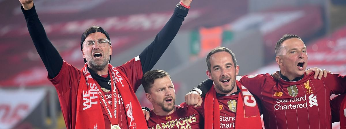 Liverpool's manager Jurgen Klopp, left, celebrates following the English Premier League soccer match between Liverpool and Chelsea at Anfield Stadium in Liverpool, England, Wednesday, July 22, 2020. Liverpool are champions of the EPL for the season 2019-2020.