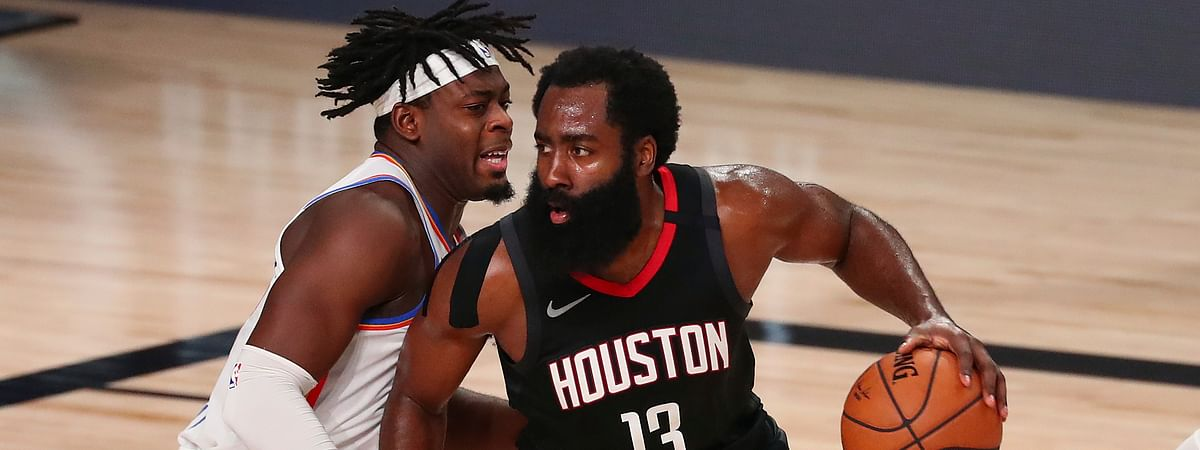 Houston Rockets guard James Harden (13) drives against Oklahoma City Thunder guard Luguentz Dort (left) during the second half of Game 4 of an NBA basketball first-round playoff series, Monday, Aug. 24, 2020, in Lake Buena Vista, Fla.