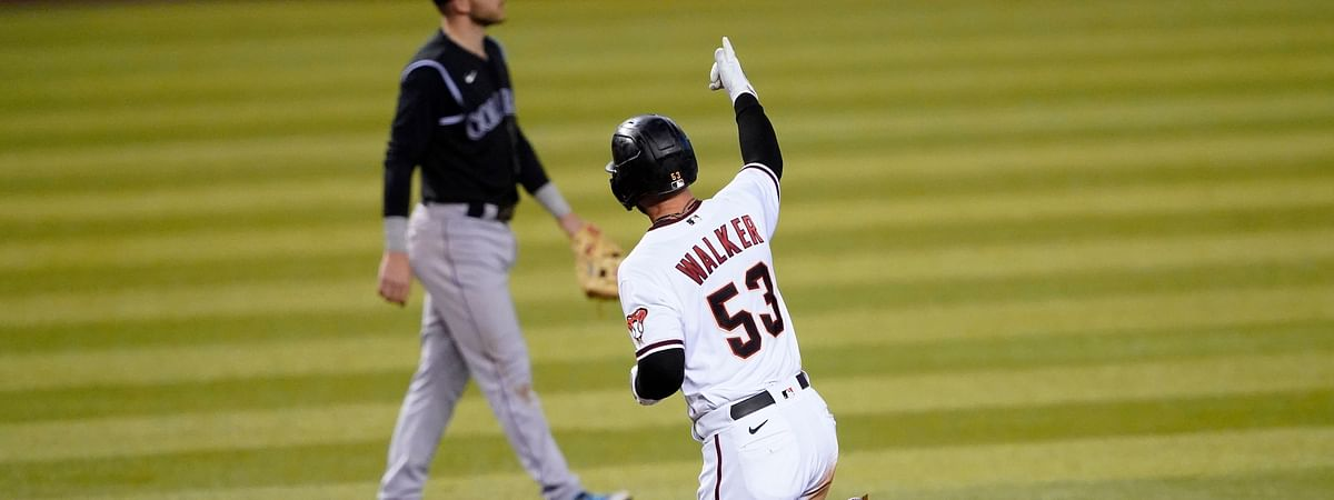 A scene Eckel would like to see repeated: Arizona Diamondbacks' Christian Walker (53) rounds the bases after hitting a solo home run as Colorado Rockies' Trevor Story looks away during the fourth inning of a baseball game, Monday, Aug. 24, 2020, in Phoenix.