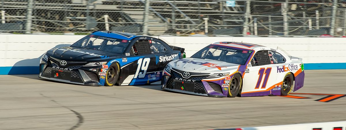 Martin Truex Jr. (19) and Denny Hamlin (11) drive during the NASCAR Cup Series auto race at Dover International Speedway, Saturday, Aug. 22, 2020, in Dover, Del.