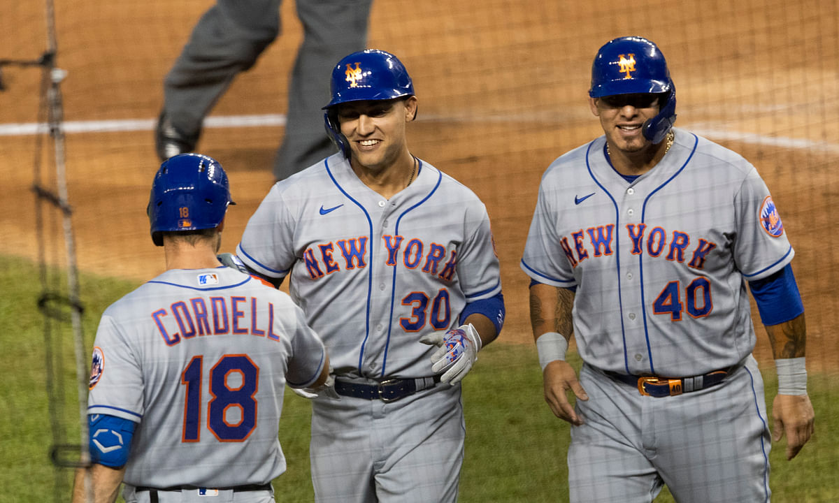 New York Mets Michael Conforto (30) is congratulated by his teammates Ryan Cordell (18) and Wilson Ramos (40) after hitting a home run during the fourth inning of a baseball game against the Washington Nationals in Washington, Tuesday, Aug. 4, 2020. Ramos also scored.