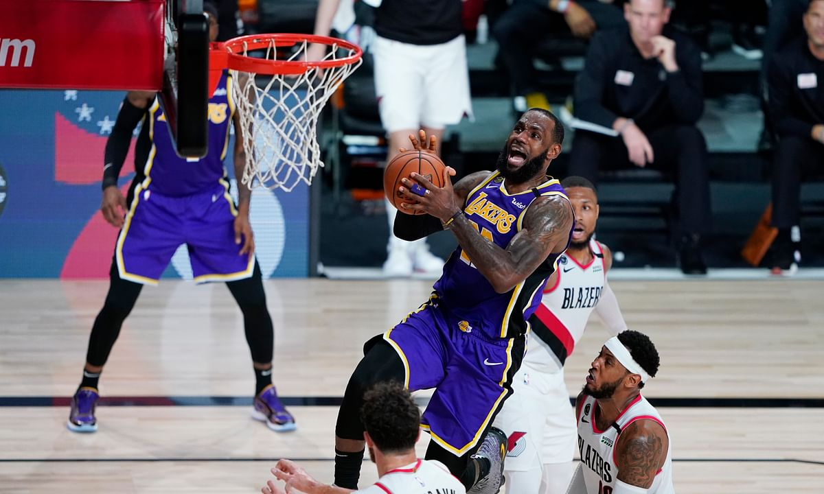 Los Angeles Lakers forward LeBron James (23) drives to the basket against the Portland Trail Blazers during the second half of an NBA basketball first round playoff game, Saturday, Aug. 22, 2020, in Lake Buena Vista, Fla.