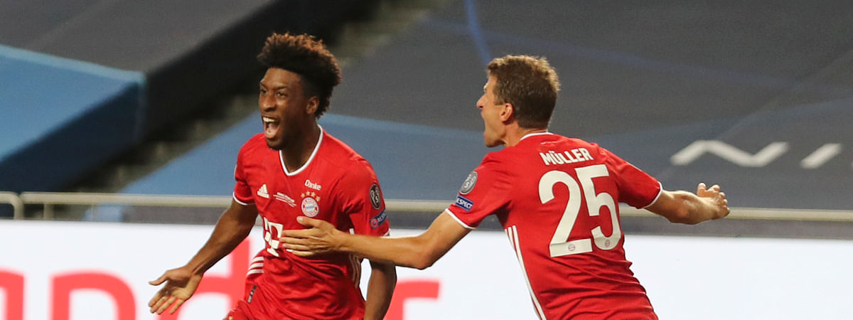 Bayern's Kingsley Coman, left, celebrates with teammate Thomas Mueller after scoring his sides first goal during the Champions League final soccer match between Paris Saint-Germain and Bayern Munich at the Luz stadium in Lisbon, Portugal, Sunday, Aug. 23, 2020.