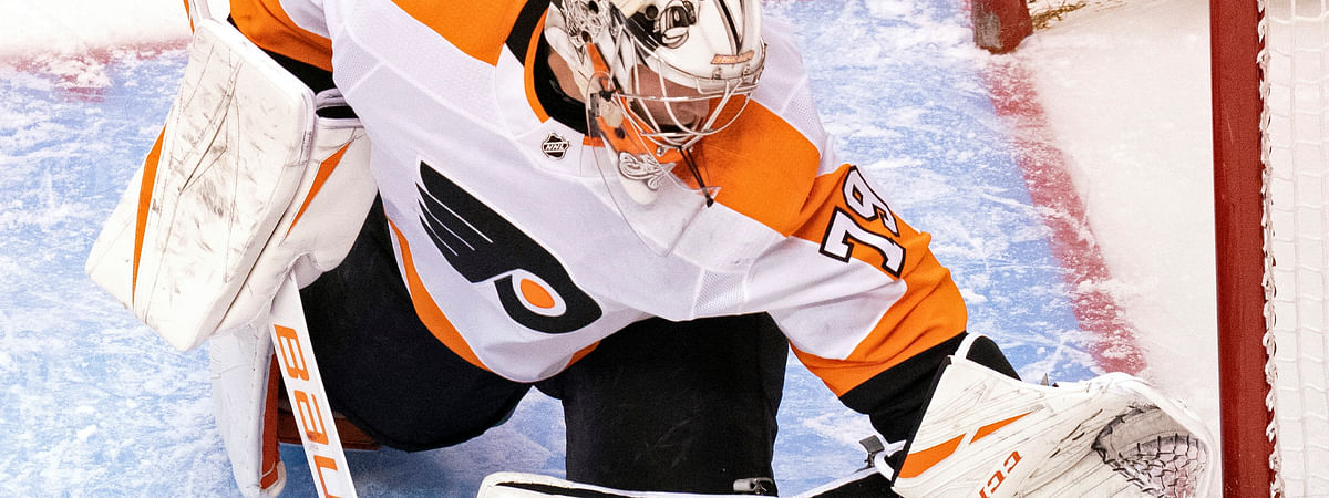 Philadelphia Flyers goaltender Carter Hart (79) makes a save against the Tampa Bay Lightning during the second period of an NHL hockey playoff game Saturday, Aug. 8, 2020, in Toronto. (Frank Gunn/