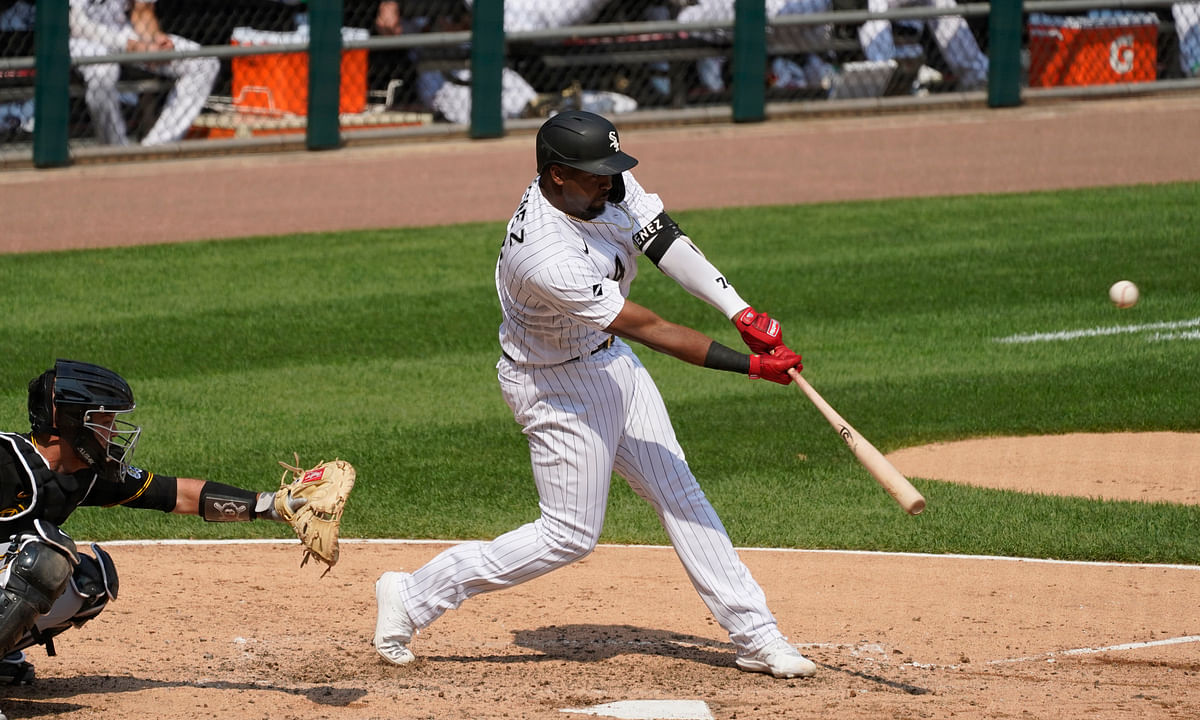 Chicago White Sox's Eloy Jimenez hits a three-run home run against the Pittsburgh Pirates during the fifth inning of a baseball game in Chicago, Wednesday, Aug. 26, 2020.