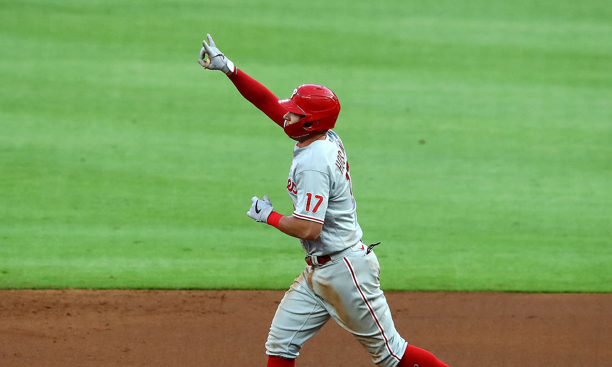 Philadelphia Phillies' Rhys Hoskins reacts after his two-run home run while rounding second base during the third inning of a baseball game against the Atlanta Braves, Sunday, Aug. 23, 2020, in Atlanta.