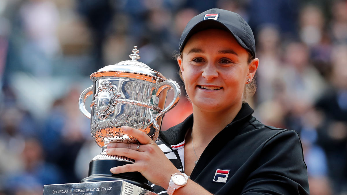 In this June 8, 2019, file photo, Australia's Ash Barty holds the trophy after winning the women's final match of the French Open tennis tournament at the Roland Garros stadium in Paris. Top-ranked Ash Barty will not defend her French Open title because of concerns over traveling during the COVID-19 pandemic.