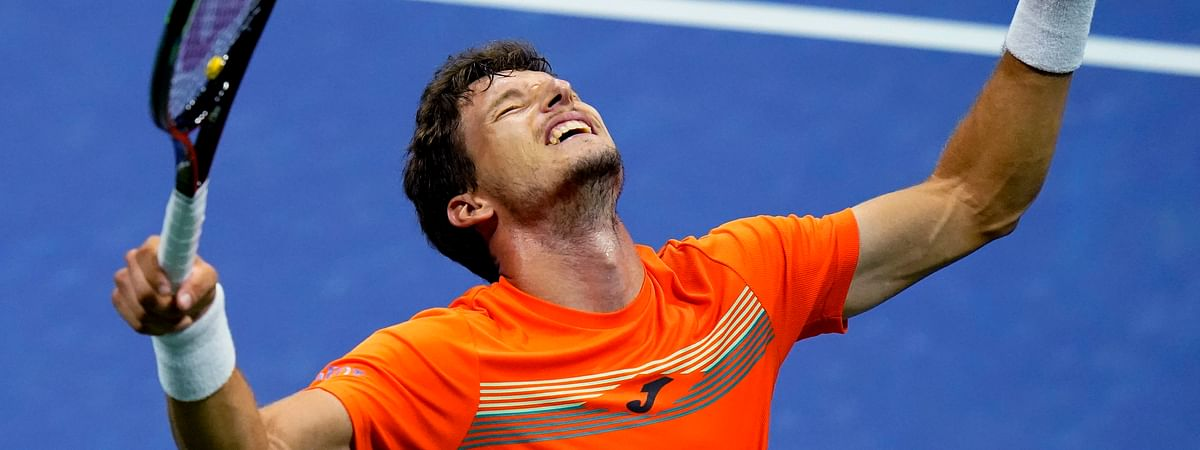 Pablo Carreno Busta, of Spain, reacts after defeating Denis Shapovalov, of Canada, during the quarterfinal round of the US Open tennis championships, early Wednesday, Sept. 9, 2020, in New York.