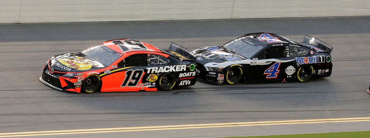 Martin Truex Jr. (19) and Kevin Harvick (4) race on the front stretch during the NASCAR Cup Series auto race at Daytona International Speedway, Saturday, Aug. 29, 2020, in Daytona Beach, Fla.