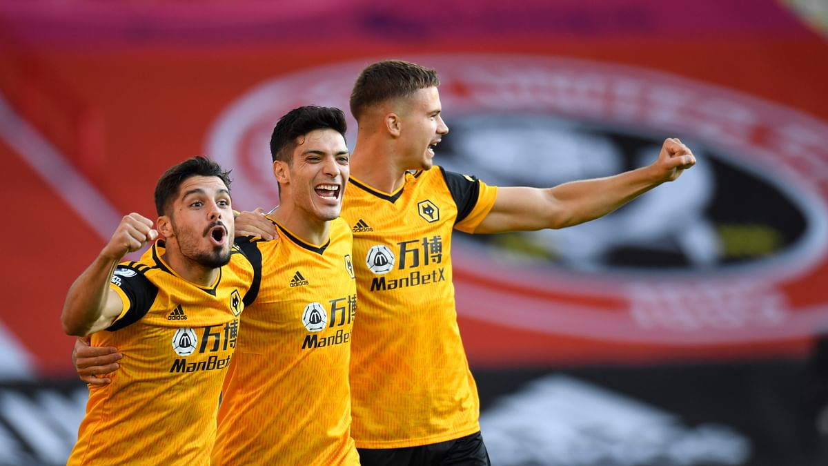 Wolverhampton Wanderers' Raul Jimenez, centre, celebrates scoring his sides first goal during the English Premier League soccer match between Sheffield United and Wolves at Bramall Lane stadium in Sheffield, England, Monday, Sept. 14, 2020.