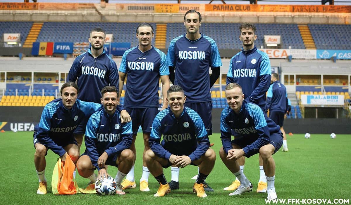 Kosovo takes a moment away from practice before their game against Moldova.