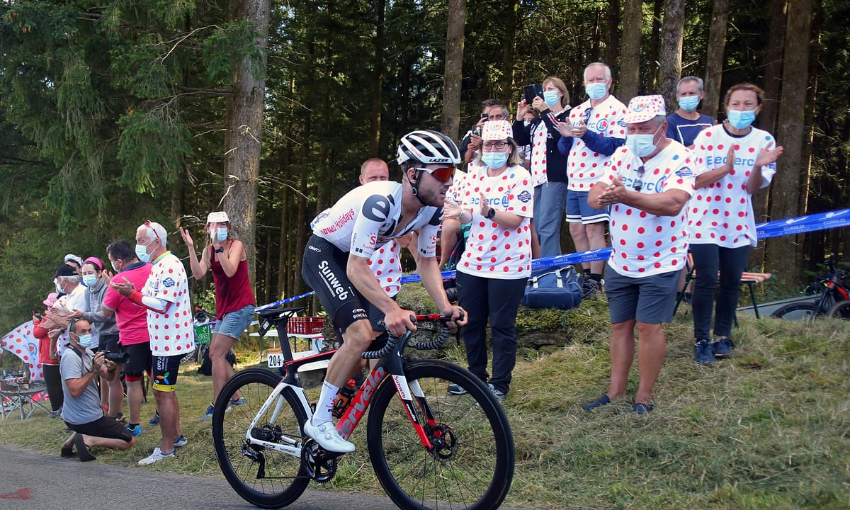 Spectators cheer Switzerland's Marc Hirschi as he climbs Suc au May pass during the stage 12 of the Tour de France cycling race over 218 kilometers from Chauvigny to Sarran, Thursday, Sept. 10, 2020.