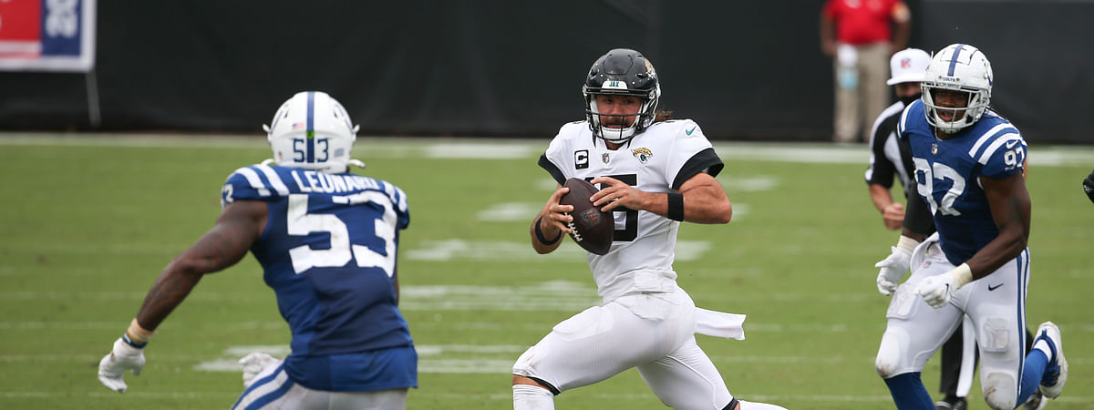 Jacksonville Jaguars quarterback Gardner Minshew, center, scrambles for yardage between Indianapolis Colts outside linebacker Darius Leonard (53) and defensive tackle Kameron Cline, right, during the second half of an NFL football game, Sunday, Sept. 13, 2020, in Jacksonville, Fla.
