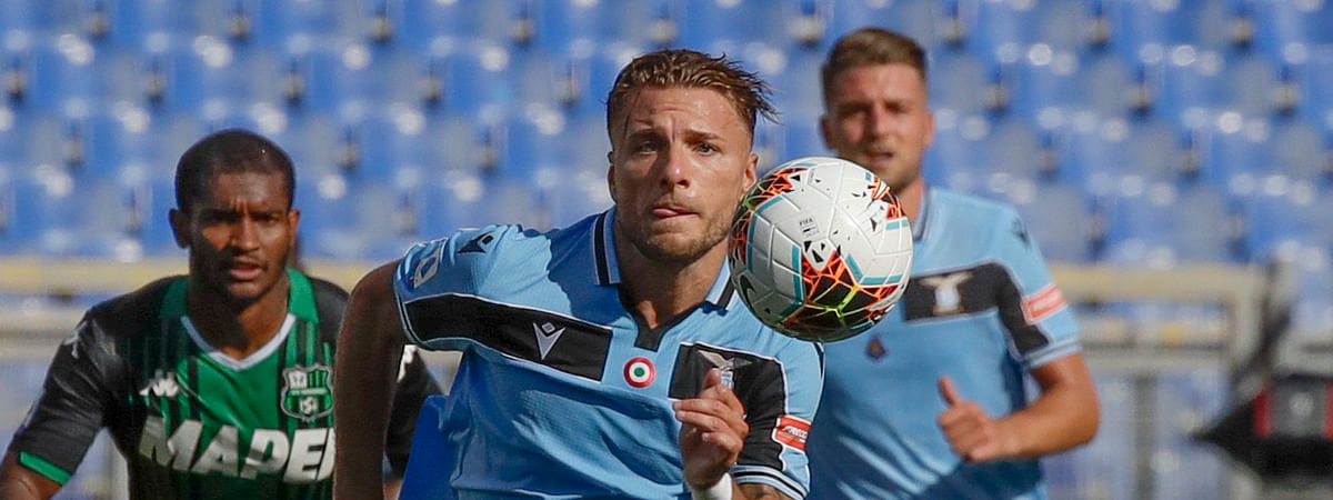 In this Saturday, July 11, 2020 file photo, Lazio's Ciro Immobile eyes the ball during the Serie A soccer match between Lazio and Sassuolo at the Rome Olympic Stadium. Italy is looking for Immobile to lead them to victory in the UEFA Nations League.