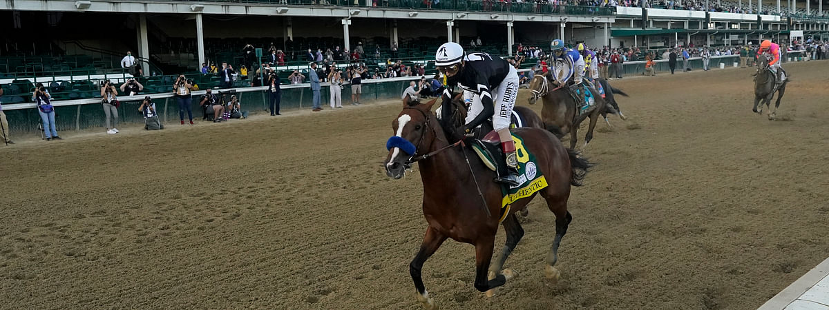 Jockey John Velazquez riding Authentic, wins the 146th running of the Kentucky Derby at Churchill Downs, Saturday, Sept. 5, 2020, in Louisville, Ky.