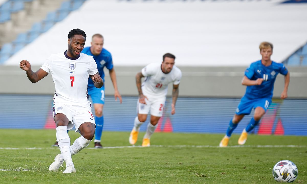 England's Raheem Sterling scores the opening goal from the penalty spot during the UEFA Nations League soccer match between Iceland and England in Reykjavik, Iceland, Saturday, Sept. 5, 2020.