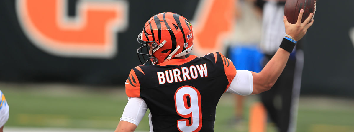 Cincinnati Bengals quarterback Joe Burrow (9) reacts after running for a touchdown during the first half of an NFL football game against the Los Angeles Chargers, Sunday, Sept. 13, 2020, in Cincinnati.