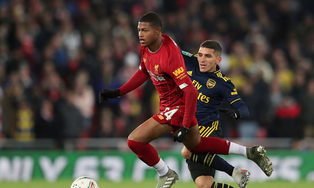 In this Wednesday, Oct. 30, 2019 file photo, Liverpool's Rhian Brewster, left, duels for the ball with Arsenal's Lucas Torreira during their English League Cup soccer match at Anfield stadium in Liverpool, England.