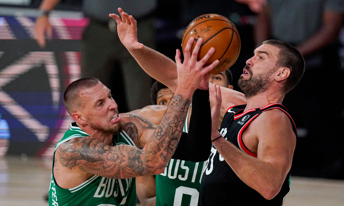 Boston Celtics center Daniel Theis (27) shoots over Toronto Raptors center Marc Gasol (33) during the second half of an NBA conference semifinal playoff basketball game Wednesday, Sept. 9, 2020, in Lake Buena Vista, Fla.