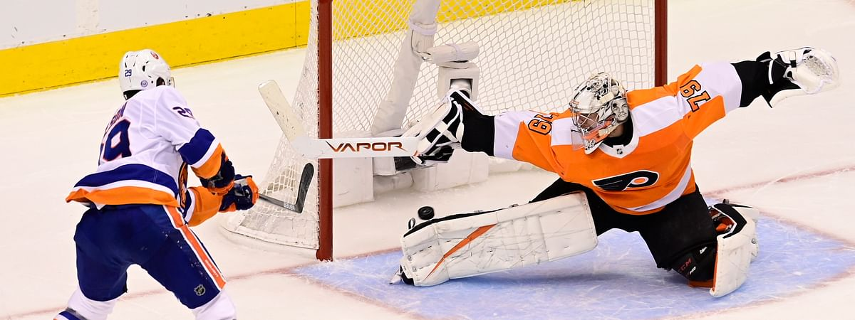 New York Islanders center Brock Nelson (29) scores against Philadelphia Flyers goaltender Carter Hart (79) during second-period NHL Stanley Cup Eastern Conference playoff hockey game action in Toronto, Saturday, Sept. 5, 2020.