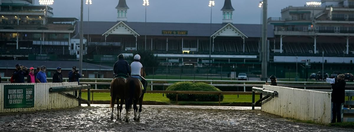 Exercise rider Heather Smullen takes Kentucky Derby entry Tiz the Law out for a workout at Churchill Downs, Wednesday, Sept. 2, 2020, in Louisville, Ky.