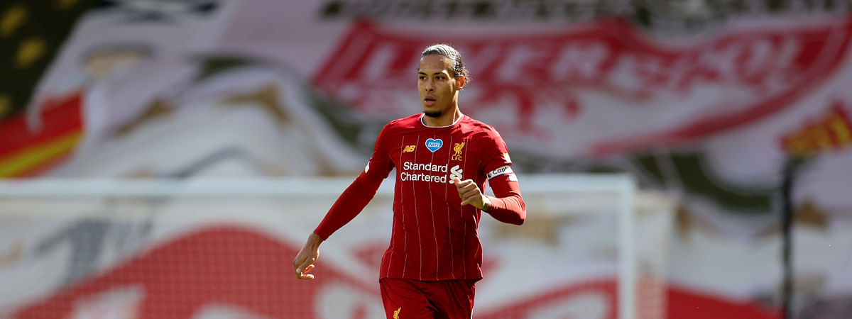 FILE - In this Sunday, July 5, 2020 file photo, Liverpool's Virgil van Dijk runs with the ball during theie English Premier League soccer match against Aston Villa at Anfield Stadium in Liverpool, England.